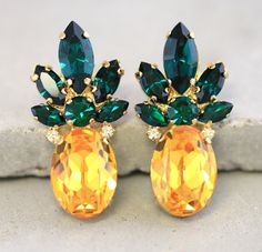 Check out this item in my Etsy shop https://www.etsy.com/listing/238116203/pineapple-stud-earringsswarovski-stud