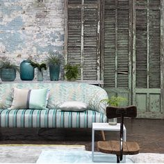 Love this colour and exposed brick wall
