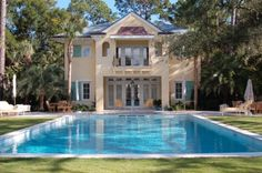 Sea Island pool and poolhouse with grass edge and Kolo collection furniture www.billyroberts.com