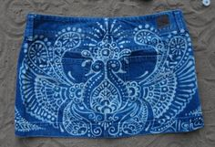 Peacocks+and+paisleys+upcycled+skirt+by+reMusedClothing+on+Etsy,+$95.00 {**This is a beautiful example of creativity with bleach! Grab a henna-mehndi pattern and a bleach pen or gel and a brush and go to town, I'd imagine...have to investigate...**}