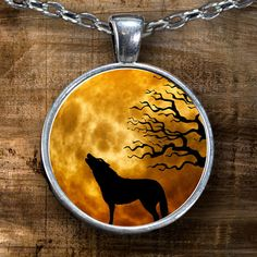 Wolf Necklace - Wolf Pendant - Wolf Profile Silhouette  Howling wolf necklace with Ominous Moon in the Sky and tree in the background. This Wolf Silhouette is howling at the moon, can you see it?  **Wolf Pendant Necklace - Choice of Silver Plated or Gun Metal.  **This Wolf Necklace comes Silver plated Or Gun Metal with a clear glass cabochon that magnifies and protects the beautiful design underneath. Shows the highest quality color and vibrance in your necklace as possible.   *****You can…