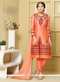 Precise elegance can come out from your dressing design with this peach cotton   churidar designer suit. This attire is well created with embroidered and resham work. Comes with matching bottom and du...