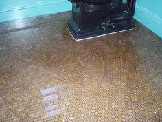 A penny floor with contractor's notes on how he laid it.