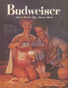 Couple beach hotdog cookout Budweiser beer ad 1960