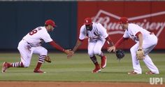 St. Louis Cardinals (L to R) Tommy Pham, Dexter Fowler and Stephen Piscotty celebrate a 3-2 victory over the Philadelphia Phillies at Busch…