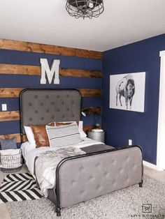 Navy Blue Boys Bedroom Rustic boy's room with dark navy walls and wood accents. Love the industrial decor and pops of pattern. Rustic Boys Bedrooms, Accent Wall Bedroom, Rustic Bedroom, Boy Bedroom Design, Bedroom Design, Blue Bedroom, Boys Bedroom Decor, Navy Blue Bedrooms, Blue Rooms