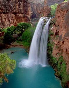Havasu Falls is a waterfall in the Grand Canyon located 1½ miles from Supai, Arizona, USA. The falls are known for their natural pools, created by mineralization, although most of these pools were damaged or destroyed in the early 1990s by large floods that washed through the area.