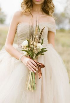 #Rustic wheat and flower bouquet | Brides.com