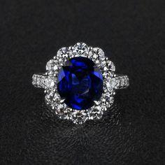 Royal Blue Sapphire & Diamond Ring in Platinum - The sapphire is 4.25 carats and the 24 Diamond equal 1.85 carat total diamond weight