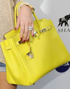 Bright yellow Hermes bag, red nails and diamonds! Perfection