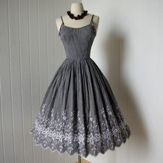 vintage 1950s dress ...best candy jones black and white gingham bullet bust embroidered full skirt pin-up dress  -featured item-. $140.00, via Etsy.