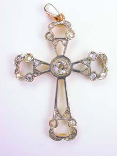 Victorian  Vintage Cross with Old Cut Diamonds, CR-3535, A bezel set old European cut diamond is set at the center of this vintage jewelry piece. Bead set rose cut diamonds are artistically placed at the end of each arm. This vintage cross is hand wrought.Details: Vintage, Victorian. Silver topped 18k yellow gold.  Old European and Rose cut diamonds; 0.42 carats.  Circa  1900.