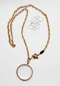 Gold Magnifying Glass Necklace With Star Toggle by whoretothecore