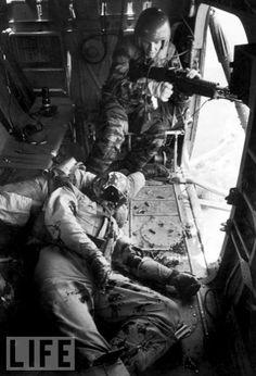 door gunner on huey chopper in vietnam war, a very dangerous job 1965