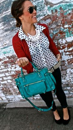 Polka dot shirt red cardigan black jeans and blue purse pretty