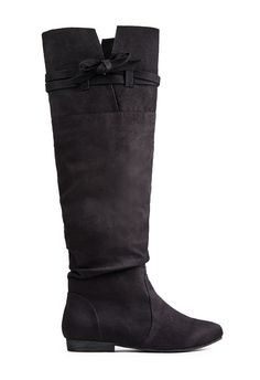 Inject some drama into your relaxed separates with Romesha by JustFab! This flat slouchy boot is a great casual go-to.