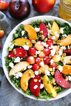 Stone Fruit Kale Salad Recipe on twopeasandtheirpod.com This simple kale salad is loaded with summer stone fruit, goat cheese, and pistachios. It is the perfect salad for summertime.