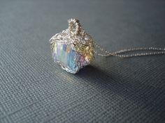 Hey, I found this really awesome Etsy listing at https://www.etsy.com/listing/217959216/swarovski-crystal-clear-cube-pendant