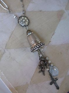THIS NECKLACE HAS BEEN PLACED ON RESERVE FOR KARIN. PLEASE DO NOT BUY. THANKS.A vintage thimble, enhanced with vintage beads and tiny rhinestones,