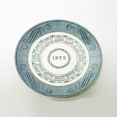 Vintage 1973 Monthly Calendar Decorative Ceramic Plate - DP658 - Vintage 1973 ceramic blue and white decorative calendar plate. Twelve monthly calendars surround the year 1973 in the center - for sale at www.ClaudiasBargains.com