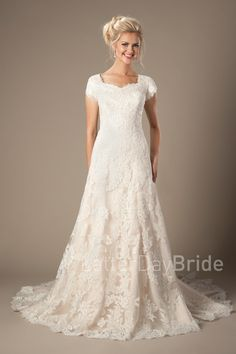 Leighton | Modest LDS Wedding Dress with Lace | LatterDayBride & Prom | SLC | UT | Worldwide Shipping | This darling modest gown features a unique tapering lace pattern and scalloped pattern.  Gown available in White, Ivory or Light Gold/Ivory   *Gown pictured in Light Gold/Ivory