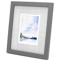The chic Swing Design Carson Frame in Grey boasts solid wood construction and a double mat with a printed linen pattern. This classic frame displays 1 photo and can stand vertically or horizontally and has hangers for wall display.