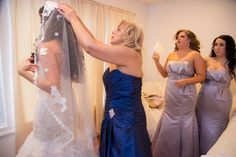 Putting the finishing touches on her daughter's wedding day look / @jlmerlino