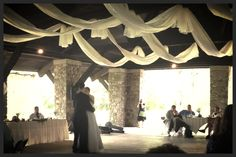 Rustic Wedding Decor: A roll of gossamer from Stumps.com, and Uncle, a cousin, and some fish line all make for a fun ceiling over the dance floor.
