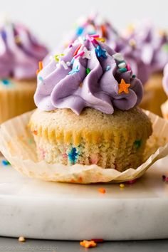 Softest fluffiest from scratch homemade funfetti cupcakes! These cupcakes are moist and flavorful with creamy vanilla buttercream!