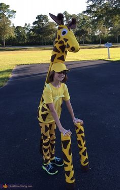 Colleen: My 10-year-old daughter Emily is wearing this giraffe costume that I made for her. It is made from recycled cardboard assembled with hot glue and covered in yellow and brown...