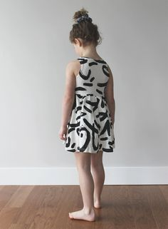 Little girl outfit: black and white graphic print dress.