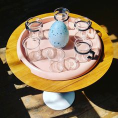 Happy Easter...postmodernism Boda Sweden handmade glass egg...Bodum Switzerland pink 80's plastic tray and cups tea time #inspiration. #artglass. #postmodernism. #bodum. #switzerland. #boda. #sweden. #plastic