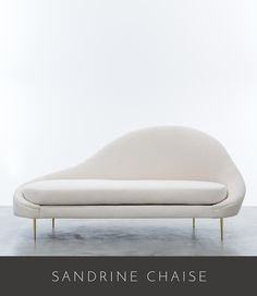 SANDRINE CHAISE 84″ LONG X 34″ OVERALL DEPTH X 40″ OVERALL HEIGHT SEAT DEPTH 23″ X SEAT HEIGHT 19″ AS SHOWN IN ICEWINE (SPB 01) WITH POLISHED BRASS LEGS