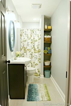 bright basement bathroom- like the shelves, curtain and colors.