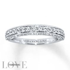From the Vera Wang LOVE Collection, this exceptional wedding band is alive with round diamonds sparkling along the band and profile. Designed to complement her matching engagement ring (sold separately), the 14K white gold ring has a total diamond weight of 3/4 carat. Diamond Total Carat Weight may range from .69 - .82 carats. #weddingbands