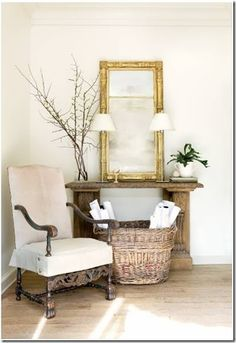 chair, antique firestone as table.  entryway.  home decor and interior decorating ideas.