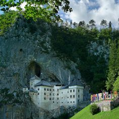 Medieval knight tournament flags at Predjama Castle, SC Slovenia (by B℮n @Flickr) •  Renaissance castle • http://en.wikipedia.org/wiki/Predjama_Castle