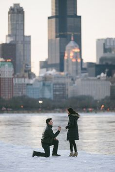He proposed with a perfect view of Chicago after the most romantic date around the city. <3