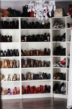 They look like Ikea Billy bookcases with corner unit to store shoes - affordable storage so the owner of this can buy more shoes!