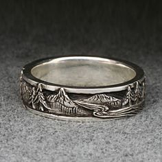 PEAKS, PINES, and RIVERS - A Highly Detailed Wedding Band in Sterling Silver. $190.00, via Etsy.