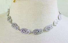 Gorgeous rhinestone necklace. The metal is silver tone. would make a beautiful necklace for a bride! great condition.  Measurements- 15-18 in long     **Check out the rest of my shop : https://www.etsy.com/shop/phatcatvintage  **Become a fan of my shop on Facebook : https://www.facebook.com/phatcatvintage   **I am happy to combine shipping. For jewelry purchases, I will fit as many items as possible into a flat rate box for $6.80. If you are in the reynoldsb...