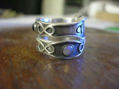 Nesting bands with infinity symbols and the Greek word for love.