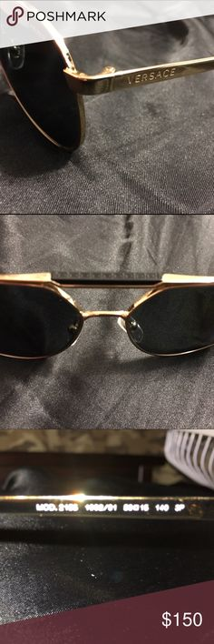 BRAND NEW POLARIZED VERSACE SHADES Gold frame with Black VERSACE logos on top, brand new but was used once, selling it because there's a better pair that I been looking at. Versace Accessories Sunglasses