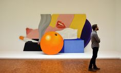 """A visitor stands in front of the painting """"Great American nude"""" from American artist Tom Wesselmann in 2014. Courtesy of PATRIK STOLLARZ/AFP/Getty Images."""