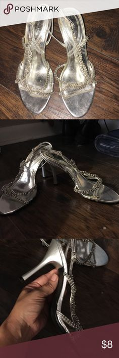 Dressy low heels Worn one time to a military ball. The heel is not too high, shocking thy were comfortable and I had a full night of dancing. There is one small jewel missing but near the the strap curves around big toe so can't notice. Shoes Heels