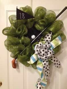 Golf wreath in green poly deco mesh.  I like this lighter green better than the last one, looks more like grass.