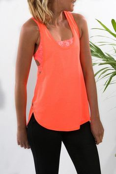 wholesale dealer f5141 b3bf4 Front view of neon orange workout tank top and matching coloured sports bra
