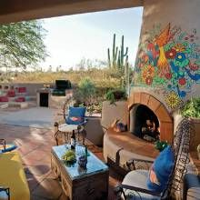 The kiva fireplace, painted with a colorful motif by local Phoenix artist Robin Ray, brings regional flavor to the sheltered patio.