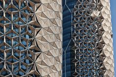 """Al Bahar Tower Abu Bhabi The practice implemented a """"mashrabiya"""". Found in traditional Islamic architecture this popular form of wooden lattice screen is used as a device for achieving privacy while reducing glare and solar gain. Aedas has reinterpreted the concept of the mashrabiya for the towers by developing a series of translucent umbrella-like components which open and close in response to the movement of the sun"""