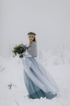 Winter bride in Šumava mountains, Czech Republic, felt like being from a fairy tale